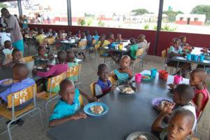 Learners at the Eiseb Primary School Hostel enjoying a meal in their newly built dining area (kitchen attached) the 2016 project